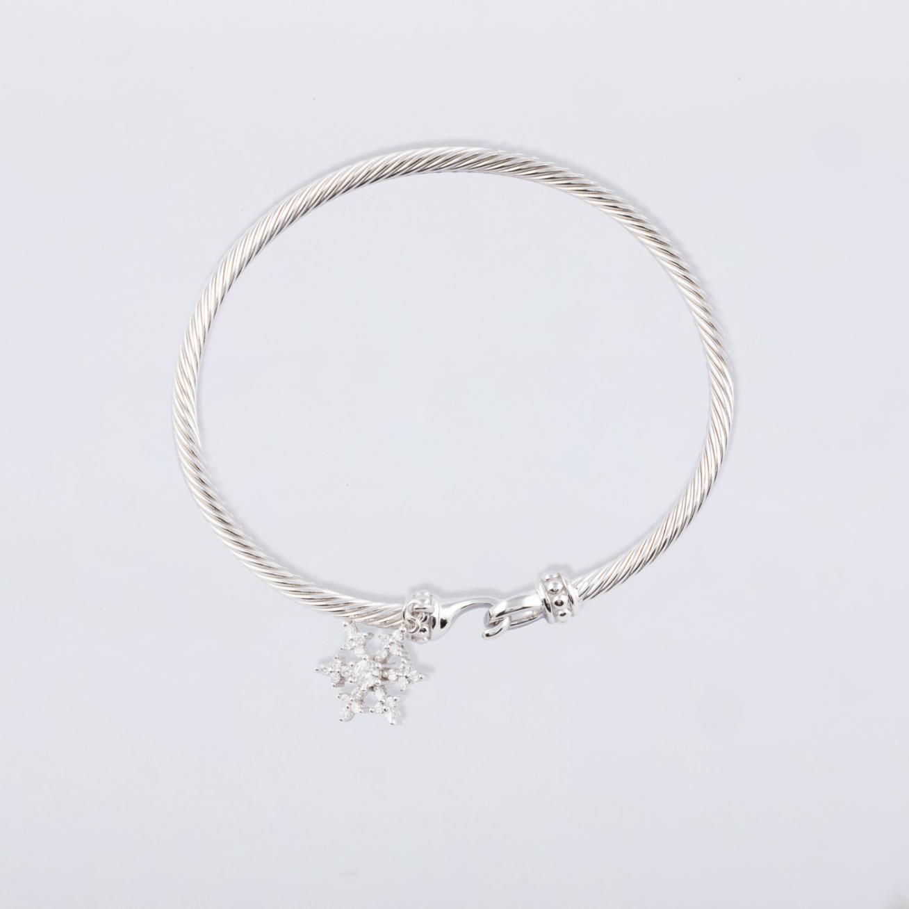 Bangle with snowflake pendant in white zircons